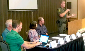 Hayden Lake Watershed Association Board members listen to the County Sheriff's Deputy.