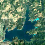 Aerial view of Hayden Lake shows treatment areas for August Noxious Weed treatment.